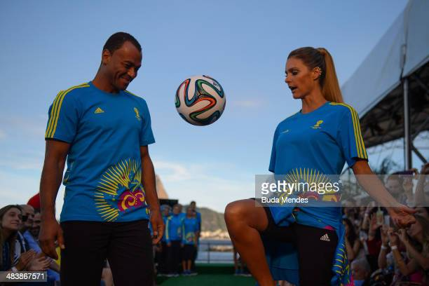 Brazilian former player Cafu and brazilian TV presenter and model Fernanda Lima walks the runway of Volunteers Uniform Launch 2014 FIFA World Cup...