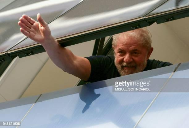 Brazilian former president Luiz Inacio Lula da Silva waves from a window of the Metallurgical Union in Sao Bernardo do Campo Sao Paulo state Brazil...