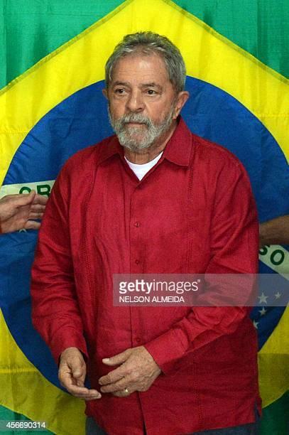 Brazilian former President Luiz Inacio Lula da Silvais seen after voting at a school in Sao Bernardo do Campo 25 km south of Sao Paulo during...
