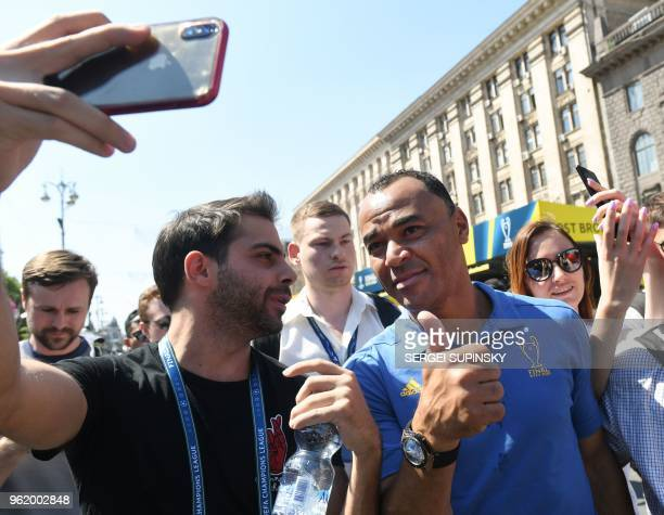 Brazilian former professional footballer Marcos Evangelista de Moraes known as Cafu poses for a selfie picture at the fan zone in Kiev on May 24...