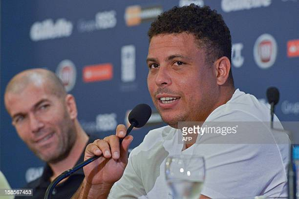Brazilian former striker Ronaldo Nazario speaks as French former footballer Zinedine Zidane looks on during a press conference to announce The Match...