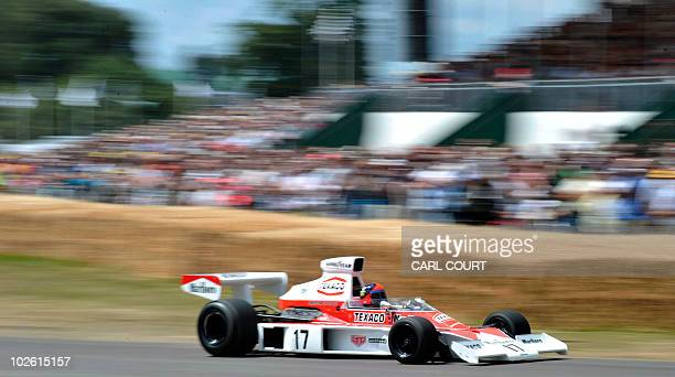 Brazilian Formula 1 driver Emerson Fittipaldi drives a 1973 McLarenCosworth M23 F1 past the crowd during the Goodwood Festival of Speed on July 4...