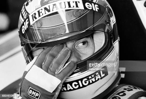 Brazilian Formula 1 race car driver Ayrton Senna touches his eye in his car before a qualifying round of the San Marino F1 Grand Prix on the Imola...