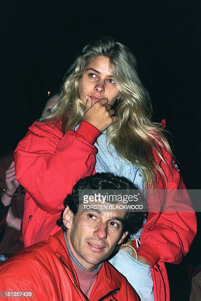 Brazilian Formula One champion Ayrton Senna and his girlfriend Adriana Galisteu watch a video of Senna's greatest moments in F1 racing in Adelaide...