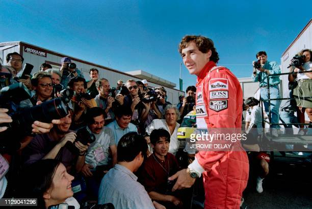 Brazilian Formula One champion Ayrton Senna poses for photographers on March 7, 1991 after the general drivers meeting in preparation for the Phoenix...