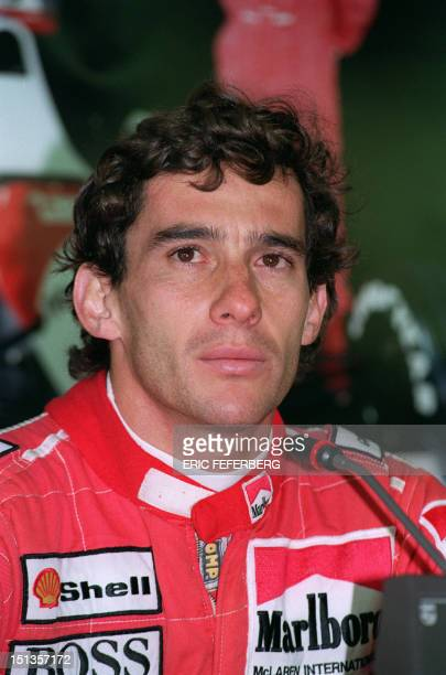 Brazilian Formula One champion Ayrton Senna speaks to the press 14 May 1991 during time trials for the French F1 Grand Prix to be held in...