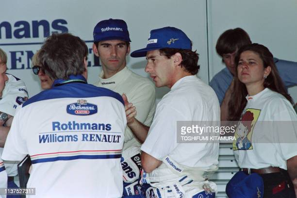 Brazilian Formula One driver Ayrton Senna chats with his mechanics in the pits after teh second to qualifying practice session of the Pacific Grand...