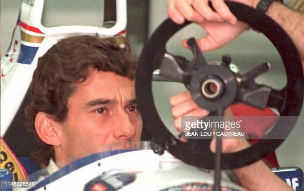 Brazilian Formula One driver Ayrton Senna inspects his steering wheel before the start of the San Marino Grand Prix in a 01 May 1994 file photo A...