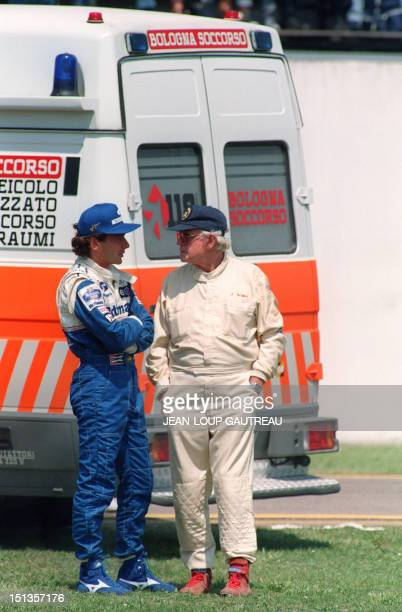 Brazilian Formula One driver Ayrton Senna talks with FISA doctor Sidney Watkins after the crash of Roland Ratzenberger during the second practice on...
