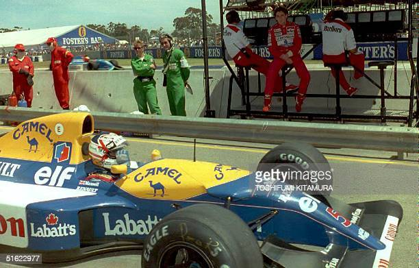 Brazilian Formula One driver Ayrton Senna watches 1992 World Champion Nigel Mansell of Britain as he returns to his pit after the second qualifying...