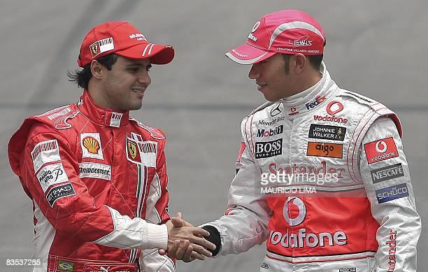 Brazilian Formula One driver Felipe Massa of Ferrari shakes hands with British Lewis Hamilton of McLaren on November 2 2008 at the Interlagos race...