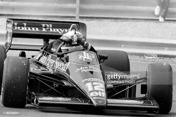 Brazilian Formula One pilot Ayrton Senna driving the Lotus 98T gives a thumb on September 13, 1985 during the first practice sessions of the Belgian...