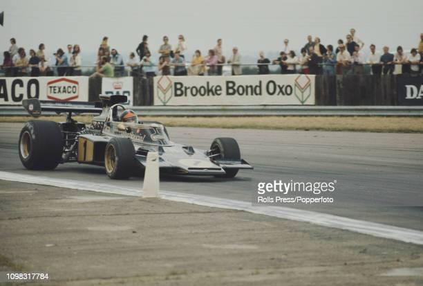 Brazilian Formula One racing driver Emerson Fittipaldi drives the John Player Team Lotus Lotus 72E Ford V8 in the 1973 British Grand Prix at...