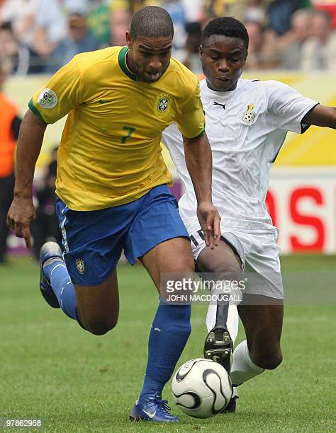 Brazilian forward Adriano vies with Ghanaian midfielder Eric Addo during the round of 16 World Cup football match between Brazil and Ghana at...