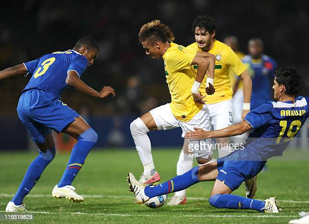 Brazilian forward Alexandre Pato watches as teammate Neymar is marked by Ecuadorean defenders Frickson Erazo and Norberto Araujo during a 2011 Copa...