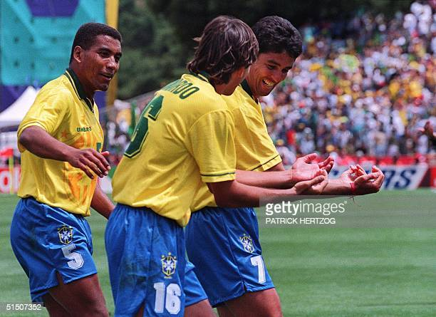 Brazilian forward Bebeto imitated by Leonardo celebrates his goal against Cameroon as Mauro Silva looks on during their World Cup first round soccer...