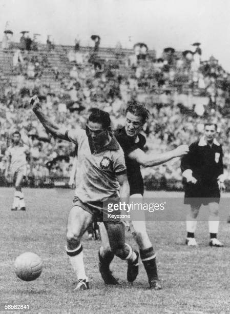Brazilian forward Didi and Hungarian fullback Mihaly Lantos in action during a World Cup quarterfinal match at the Wankdorf Stadium Berne Switzerland...