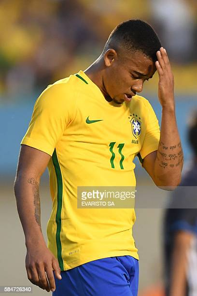 Brazilian forward Gabriel Jesus reacts after missing a goal opportunity during a friendly football match against Japan ahead of the Rio 2016 Olympic...