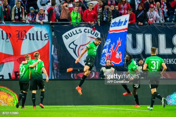 TOPSHOT Brazilian forward Jonathas celebrates with his teammates after scoring during the German first division Bundesliga football match RB Leipzig...