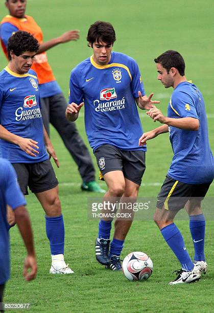 Brazilian forward Kaka passes the ball with teammates during a training session on the eve of their football match against Venezuela for a FIFA World...