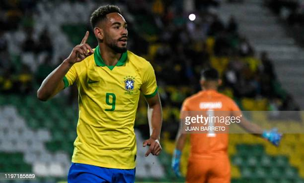 Brazilian forward Matheus Cunha celebrates after scoring against Bolivia during their Under23 South American PreOlympic Tournament football match at...