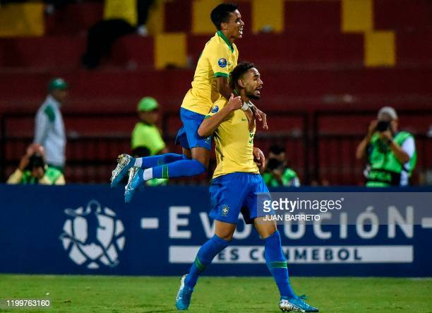 Brazilian forward Matheus Cunha celebrates his second goal against Argentina during the Under23 South American PreOlympic Tournament final football...