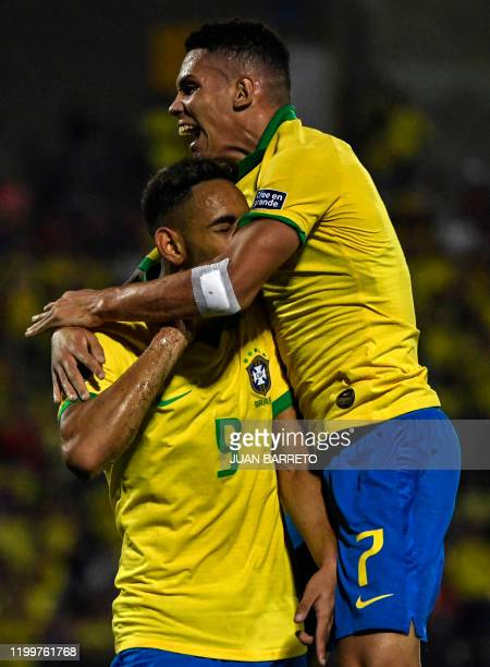 Brazilian forward Matheus Cunha celebrates with Brazilian forward Paulinho his goal against Argentina during the Under23 South American PreOlympic...