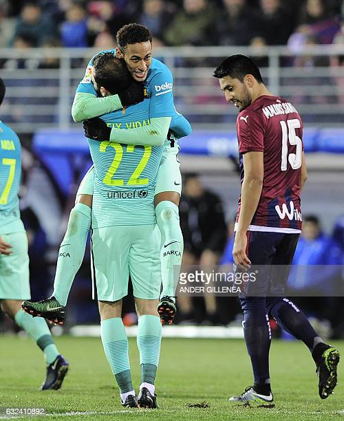 Brazilian forward Neymar celebrates with Barcelona's defender Aleix Vidal after scoring his team's fourth goal during the Spanish league football...