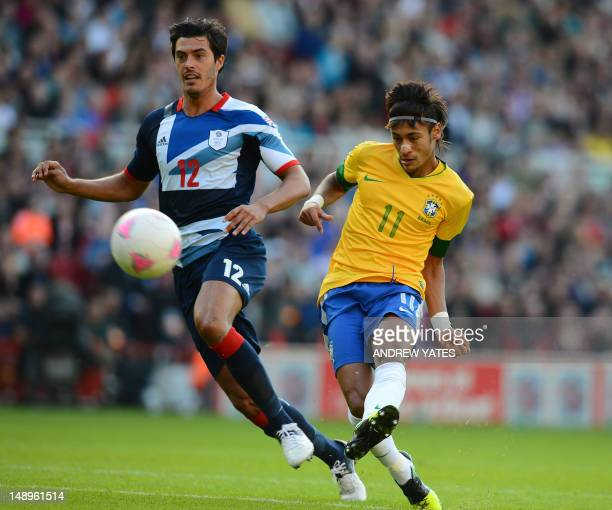 Brazilian forward Neymar shoots past Great Britain defender James Tomkins during their London 2012 Olympic games warm up football match between Great...