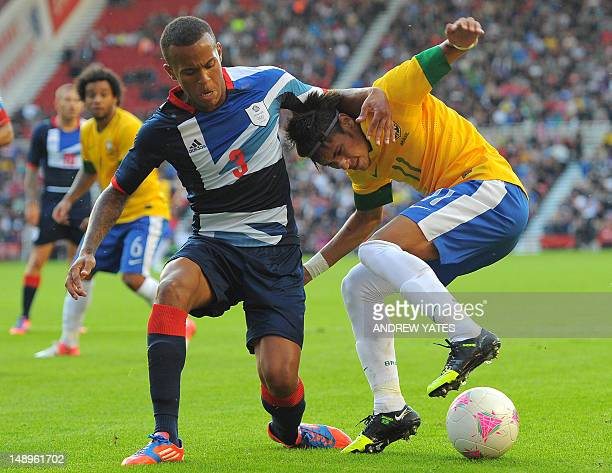 Brazilian forward Neymar vies with Great Britain defender Ryan Bertrand during their London 2012 Olympic games warm up football match between Great...