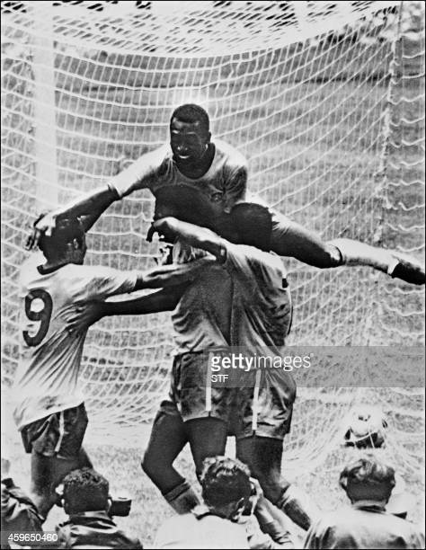 Brazilian forward Pele celebrates with his teammates Tostao Carlos Alberto and Jairzinho during the World Cup final between Brazil and Italy 21 June...