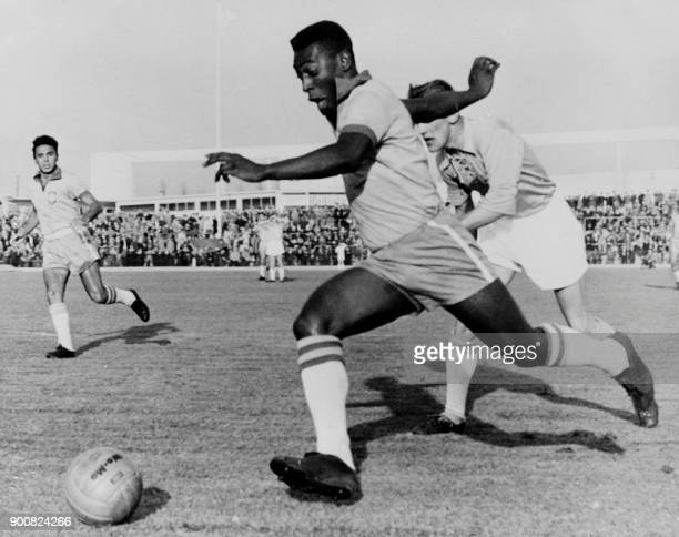 Brazilian forward Pele dribbles past a defender during a friendly match between Malmoe and Brazil on May 8 1960 in Malmoe Pele scored two goals as...