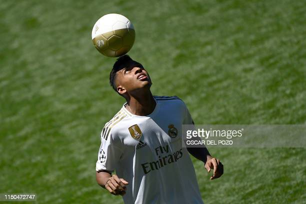 Brazilian forward Rodrygo Silva de Goes plays with a ball during his official presentation of new player of the Real Madrid CF at the Santiago...