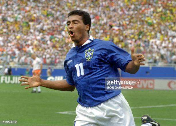 Brazilian forward Romario jubilates after scoring a goal against the Netherlands 09 July 1994 in Dallas during their World Cup quarterfinal soccer...
