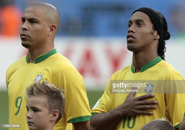Brazilian forward Ronaldo and Brazilian midfielder Ronaldinho listen the national anthems at the start of the quarter-final World Cup football match...
