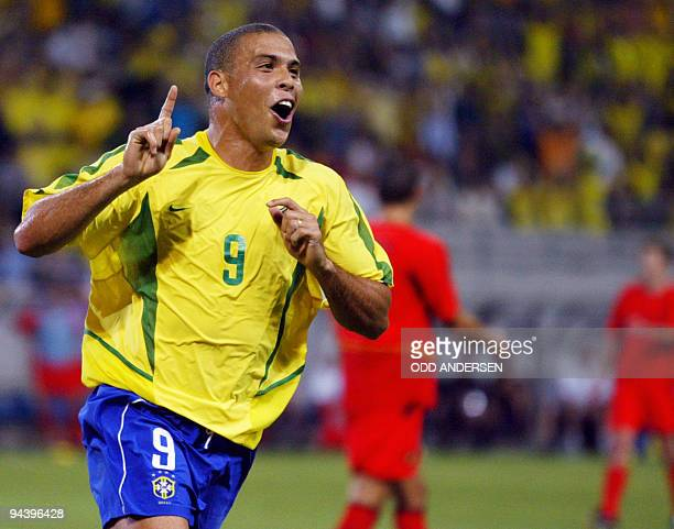 Brazilian forward Ronaldo celebrates after he scored during the second round match Brazil/Belgium of the 2002 FIFA World Cup in Korea and Japan 17...