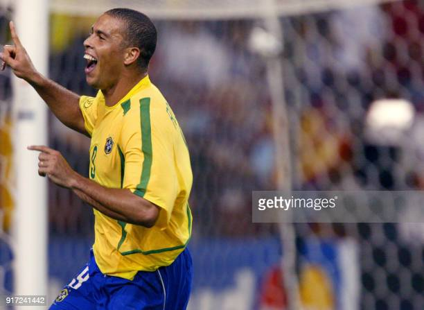 Brazilian forward Ronaldo celebrates after scoring during the Brazil/Belgium second round match of the FIFA 2002 Soccer World Cup 17 June 2002 at...