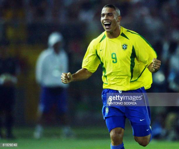 Brazilian forward Ronaldo celebrates after scoring the second Brazilian goal 30 June 2002 during the Germany/Brazil final of the 2002 FIFA World Cup....