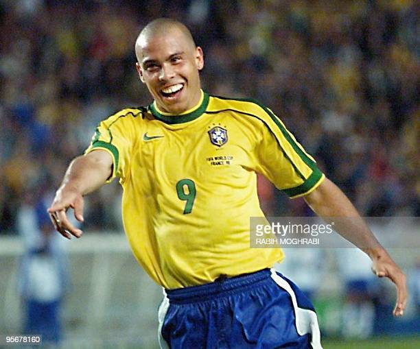 Brazilian forward Ronaldo jubilates after scoring a goal 27 June at the Parc des Princes stadium in Paris during the 1998 Soccer World Cup second...