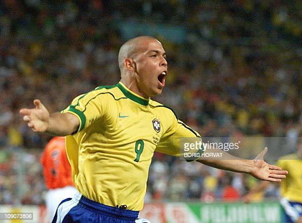 Brazilian forward Ronaldo jubilates after scoring his team's first goal, during the 1998 Soccer World Cup semi-final match against the Netherlands,...