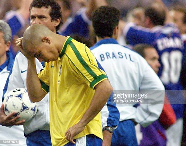 Brazilian forward Ronaldo looks dejected 12 July at the Stade de France in Saint-Denis, near Paris, after the 1998 Soccer World Cup final matchvs...