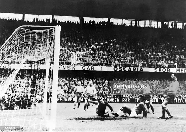 Brazilian forward Vava scores a goal past Swedish goalkeeper Kalle Svensson to tie the score at 1 during the final of the World Cup on June 29 1958...