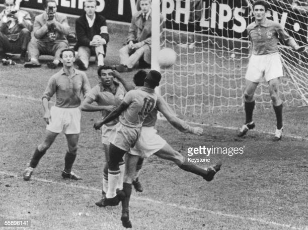 Brazilian forwards Vava and Pele enter a melee in front of the French goal during the the World Cup semifinal at the Rasunda Stadion in Solna...