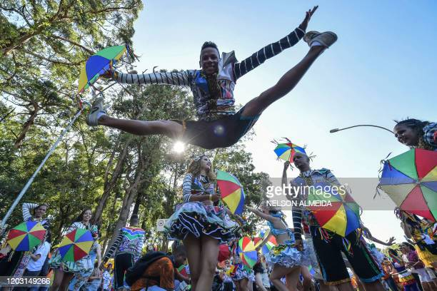Brazilian Frevo dancers perform during the traditional Galo da Madrugada carnival parade along the streets of Sao Paulo, Brazil, on February 25, 2020.