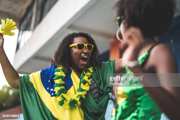 Brazilian friends watching a soccer game