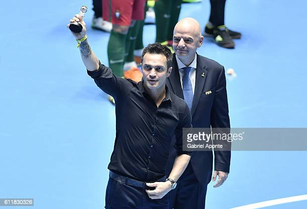 Brazilian futsal player Falcao receives an award from FIFA President Gianni Infantino during the Colombia 2016 FIFA Futsal World Cup at the Coliseo...