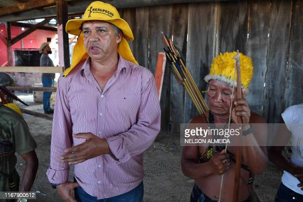Brazilian garimpeiro illegal gold miner Inacio Vilela and Carlos Augusto Cabace of the Munduruku indigenous tribe speak with AFP after a garimpeiros...