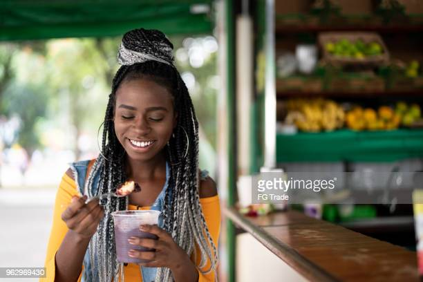 brazilian girl eating açai acai bowl - para state stock photos and pictures