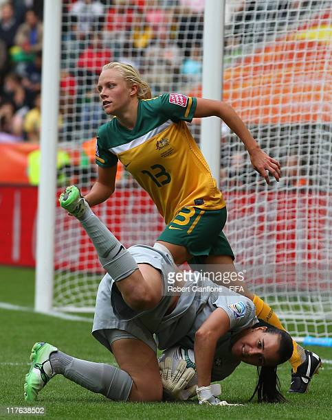 Brazilian goalkeeper Andreia takes the ball in front of Tameka Butt of Australia during the FIFA Women's World Cup 2011 Group D match between Brazil...