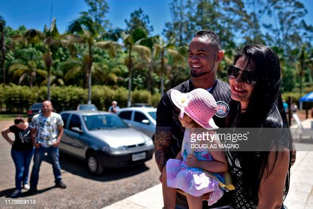 Brazilian goalkeeper Bruno attends his presentation as new goalkeeper of the Pocos de Caldas Football Club with his wife Ingrid Calheiros and their...